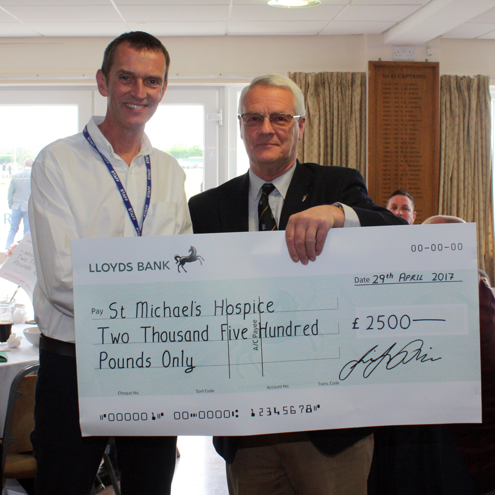 Club President Richard Powell presents St Michael's Hospice cheque