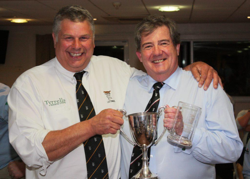 Chairman, Simon Whiteman presents Clubman of the Year award to Greg Halligan